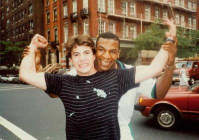 Robert Downy Jr poses with his father's friend, Mike Tyson. [c. 1980s]